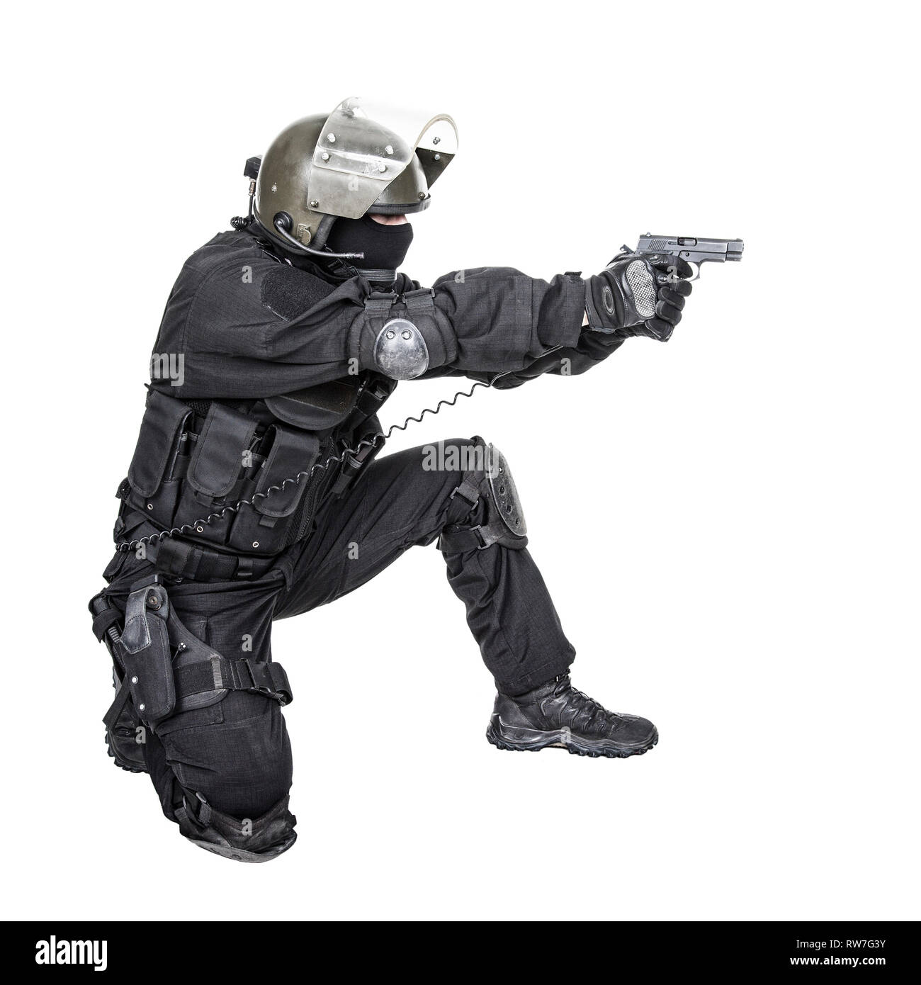 Spec ops soldier in black uniform and face mask aiming his