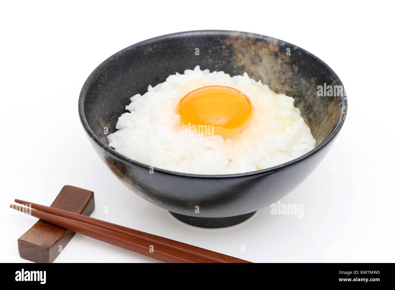 Close up of Japanese rice with raw egg, Tamago kake gohan - Stock Image