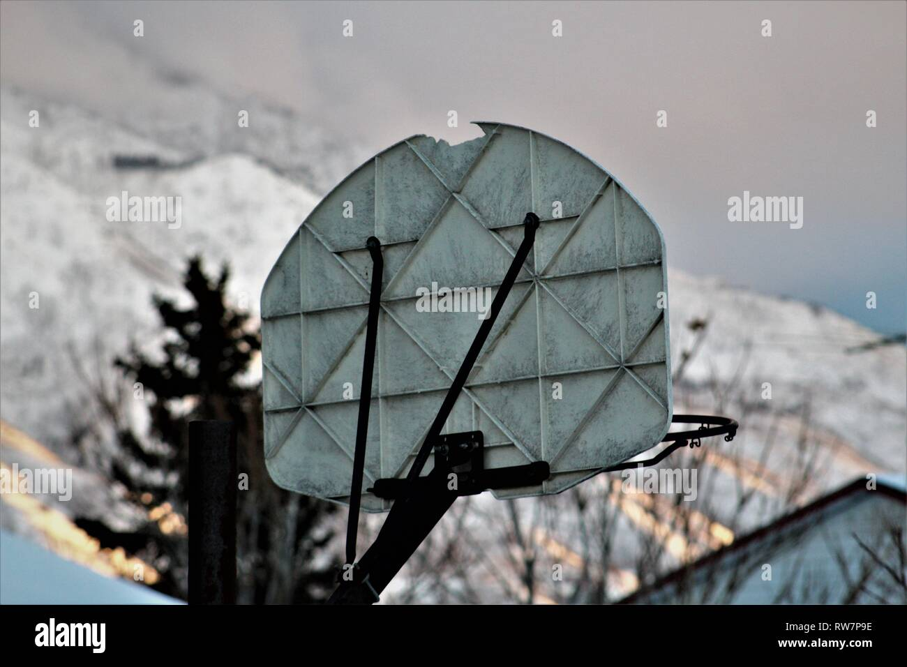 Basketball Hoop on a Snowy Day Stock Photo