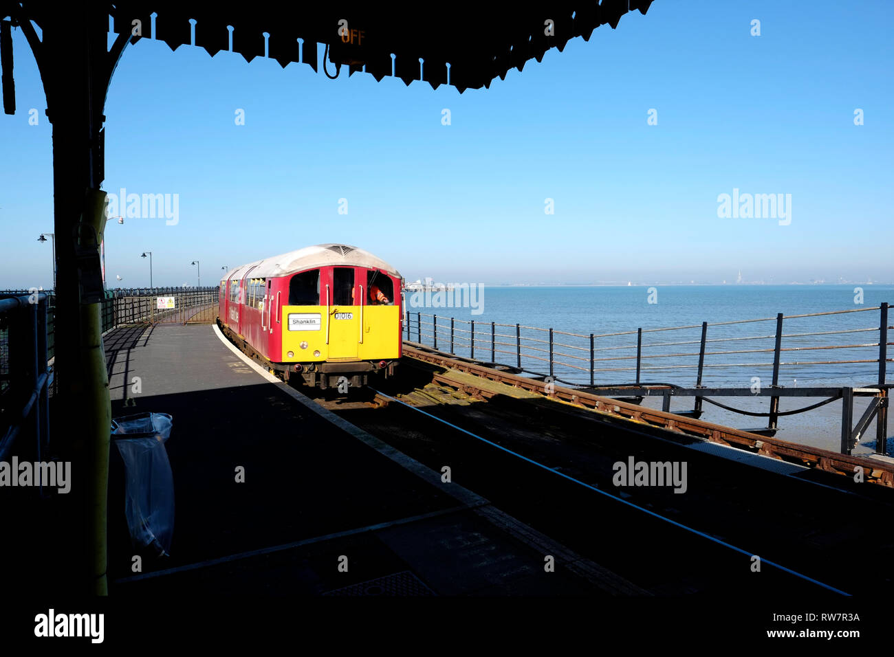An Island Line Class 483 Multiple Unit Train arriving at Ryde Esplanade Station from Ryde Pier Head station along Ryde pier, Isle of Wight, UK. - Stock Image