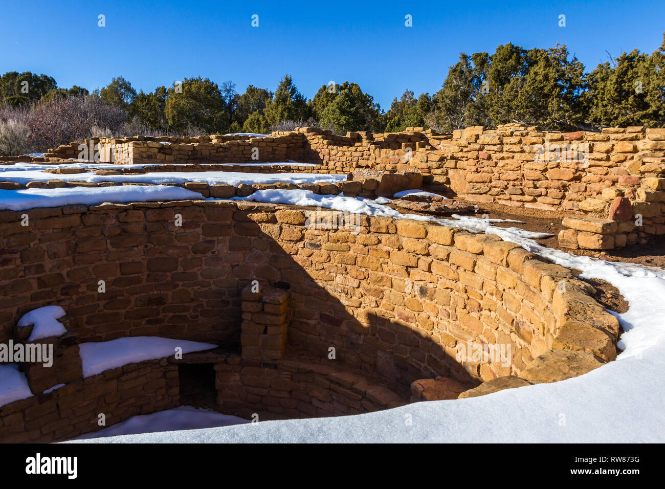 Ancient Kiva found in Mesa Verde National Park with some snow on the ground. Kivas had many uses varying from ceremonial to social or utilitarian purp Stock Photo