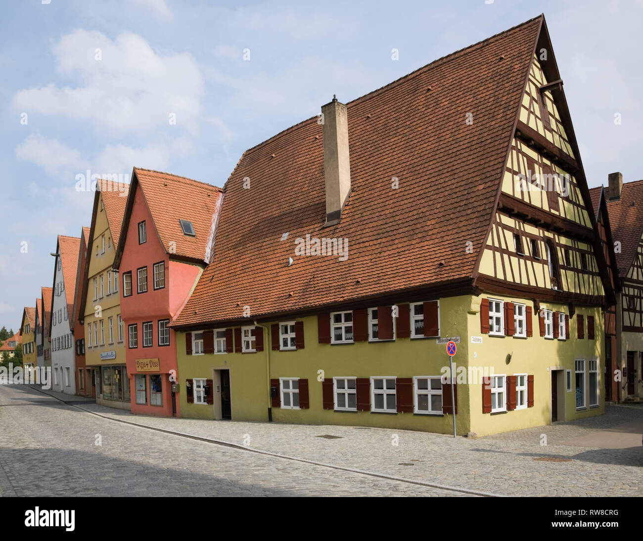 Gingerbread style commercial and residential apartment buildings in the medieval town of Dinkelsbuhl in late summer, Germany - Stock Image