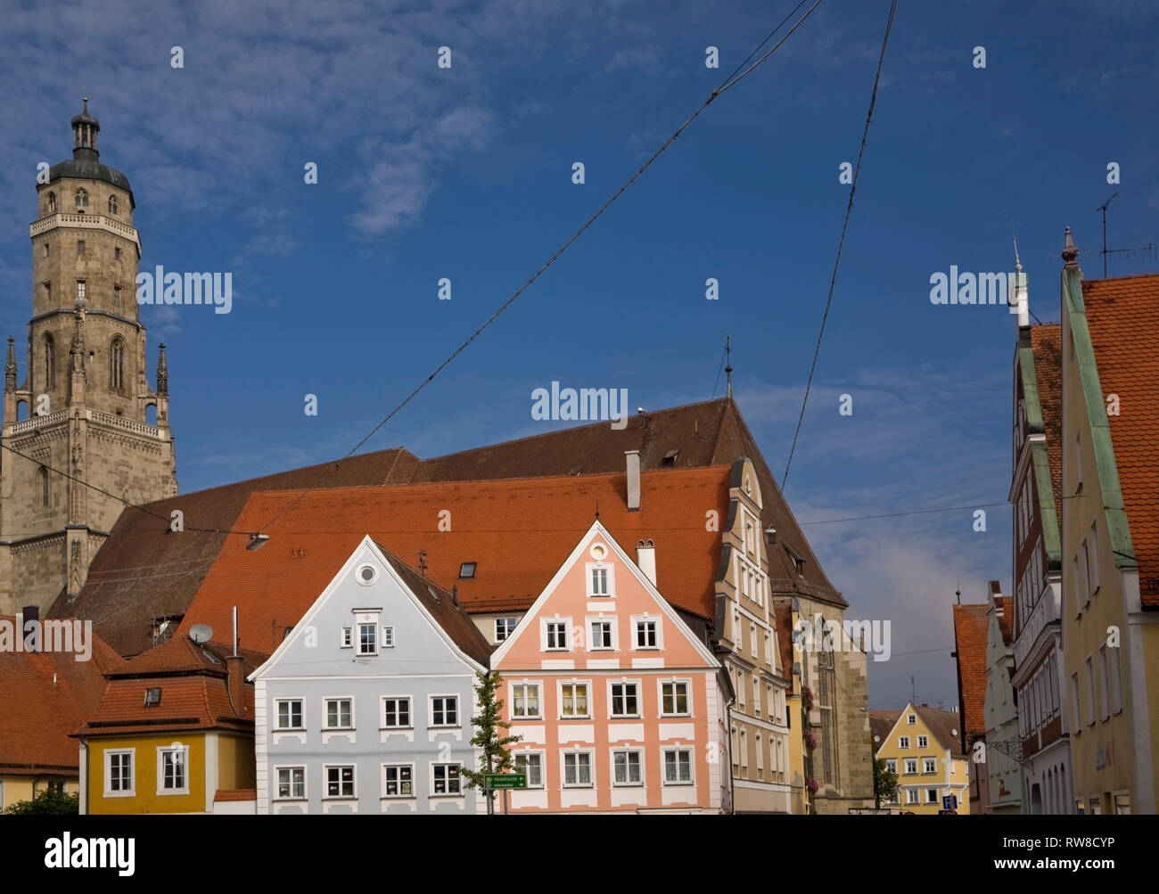 Church tower and buildings in the medieval town of Nordlingen, Bavaria, Germany - Stock Image