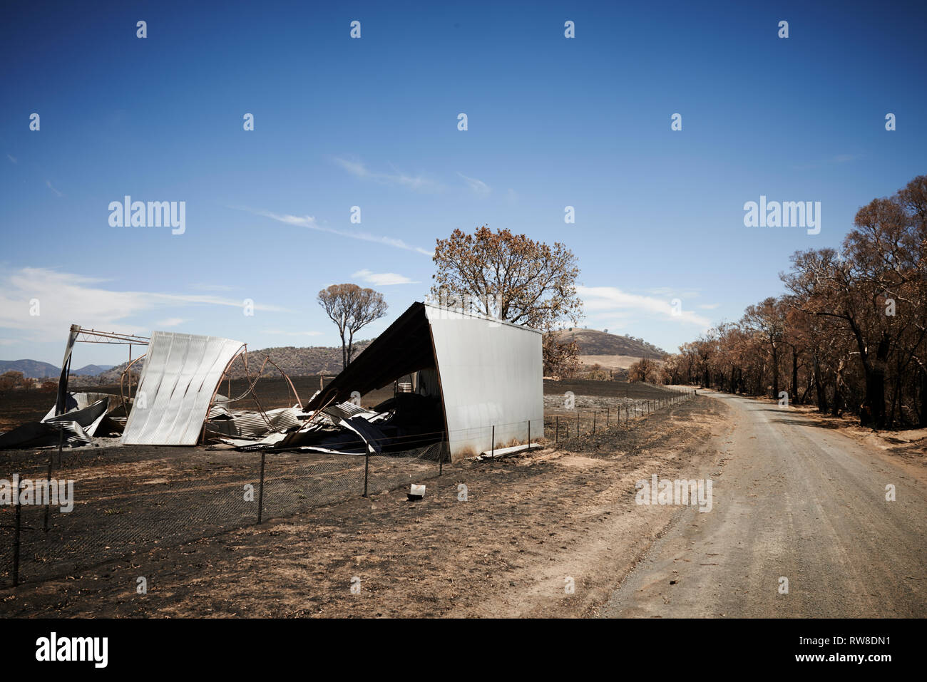 The aftermath and destruction left behind from bushfires in Bogolara Road, New South Wales, Australia. Stock Photo