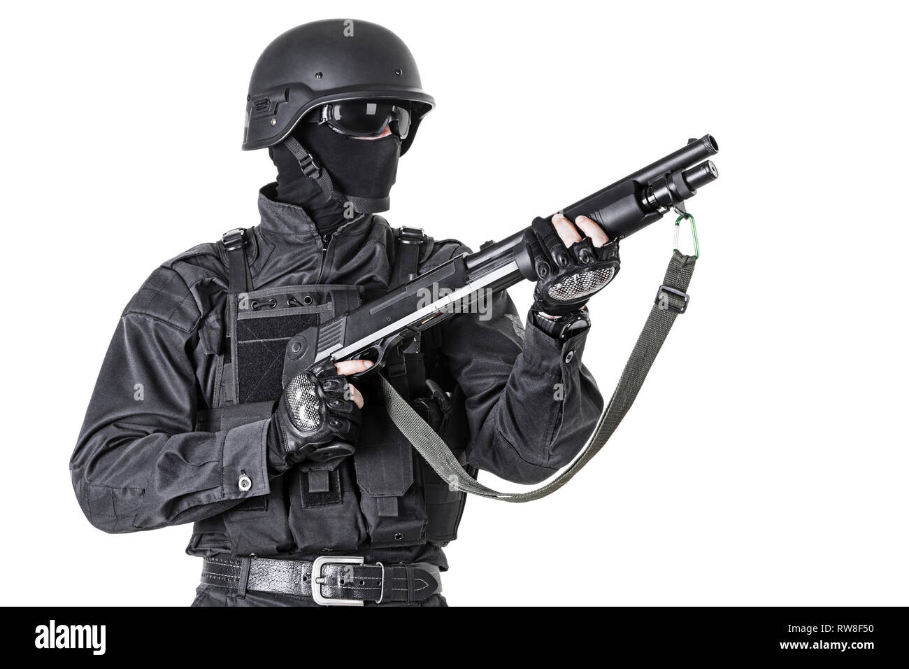 Spec ops police officer SWAT in black uniform with shotgun, studio