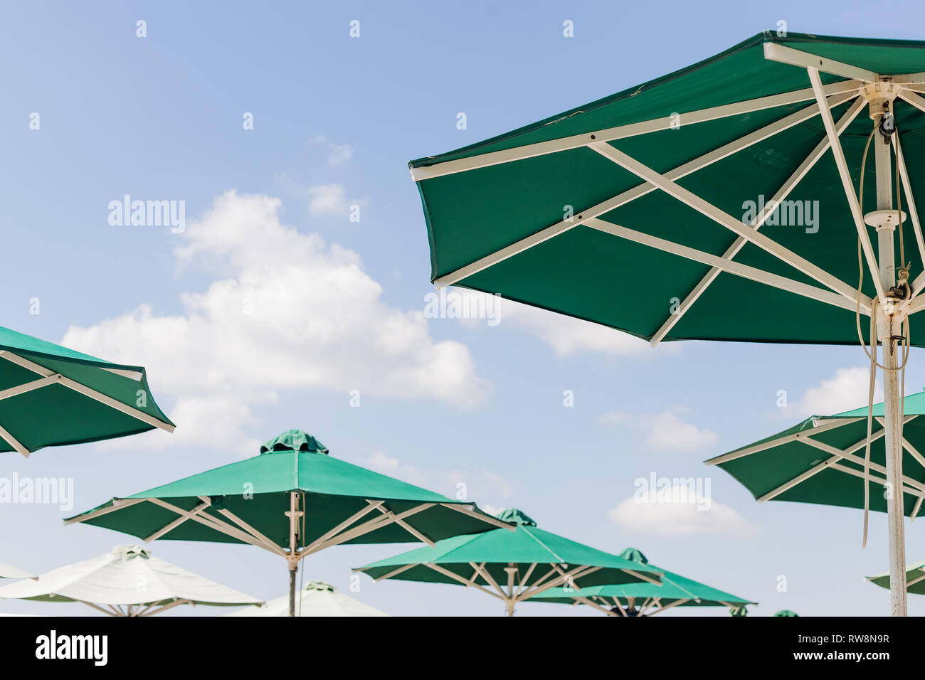 Sun Green Open Umbrella Comfortable Rest By The Ocean With Personal