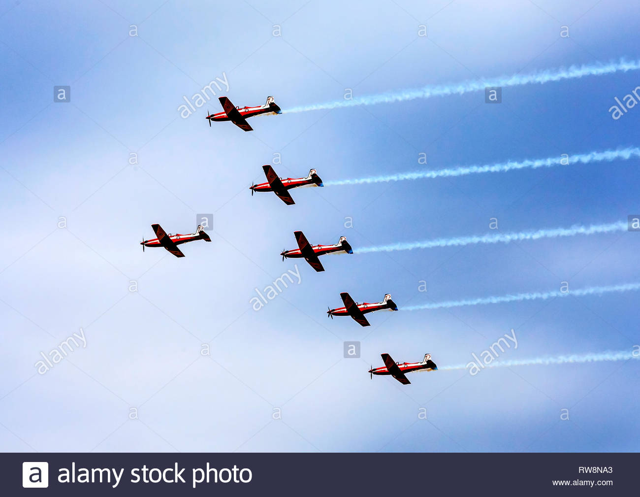 Pilatus PC-9 aircraft in formation perform at Temora Warbirds Downunder Air Show for the last time before being replaced by the Pilatus PC-21 - Stock Image