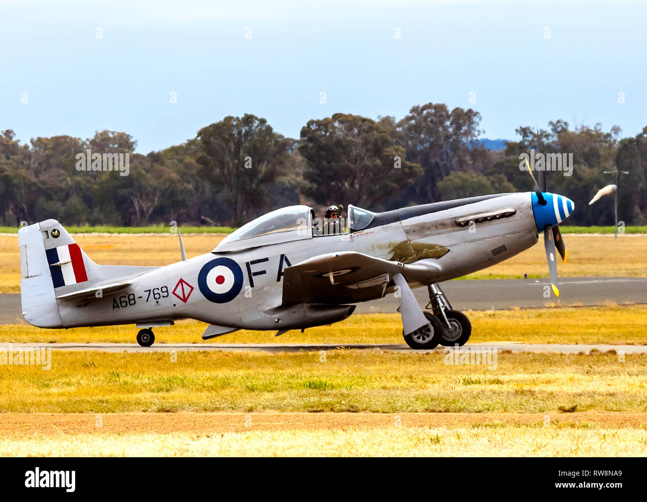 CAC North American Mustang  taxiing at Temora Warbirds Downunder Air Show - Stock Image