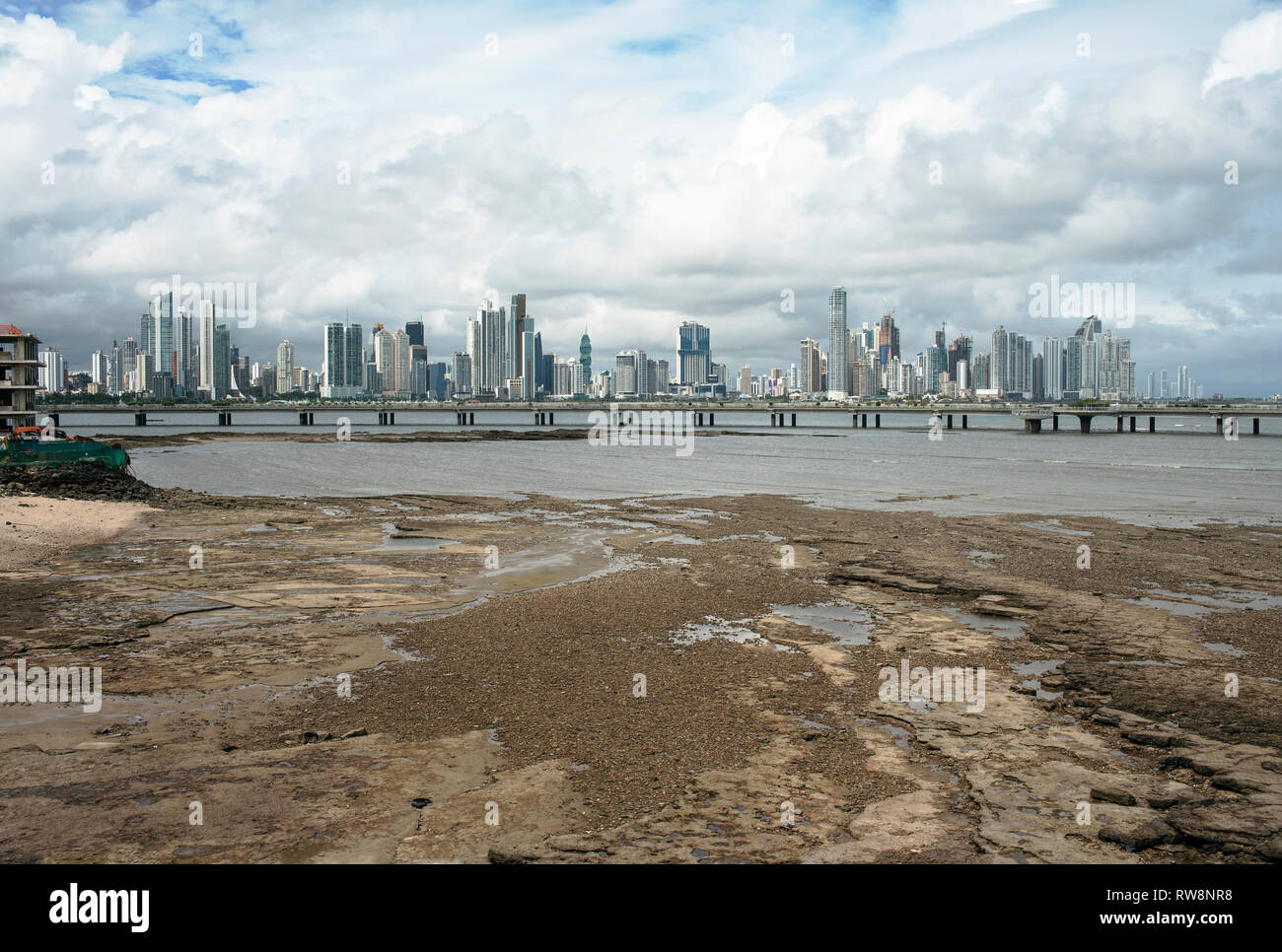 Low tide views of Panama City with Cinta Costera highway and Punta Paitillas impressive skyline in the background. Panama, Central America. Oct 2018 - Stock Image