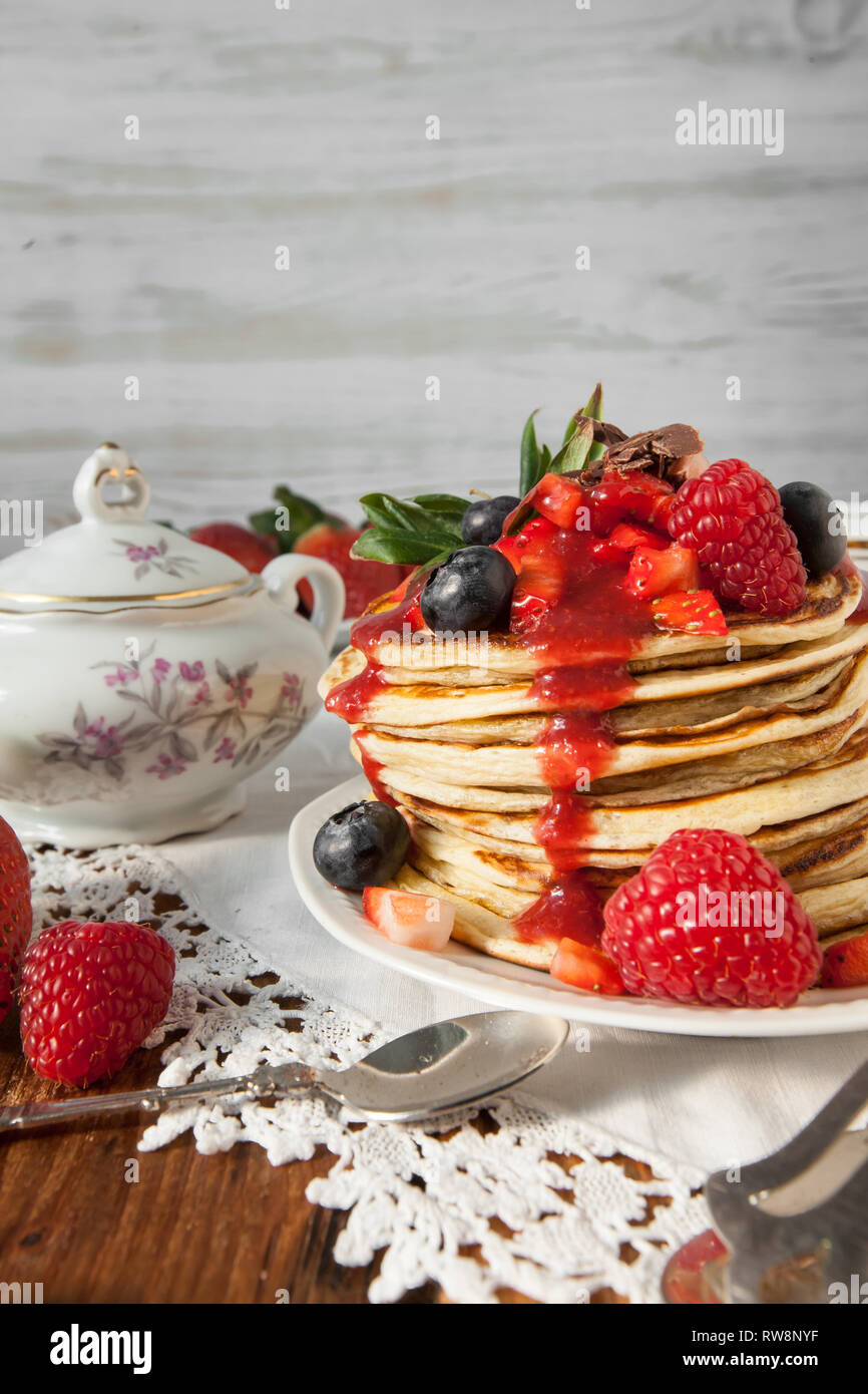 Strawberry chocolate pancakes on a vintage table Stock Photo