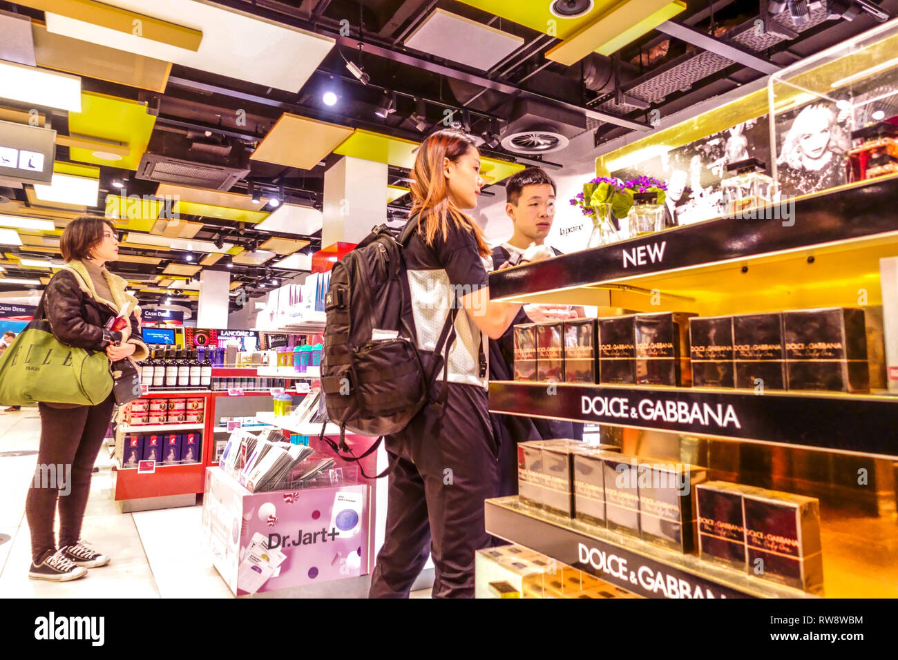 People shopping before departure in Duty-free shop at Vienna airport, Dolce & Gabbana - Stock Image