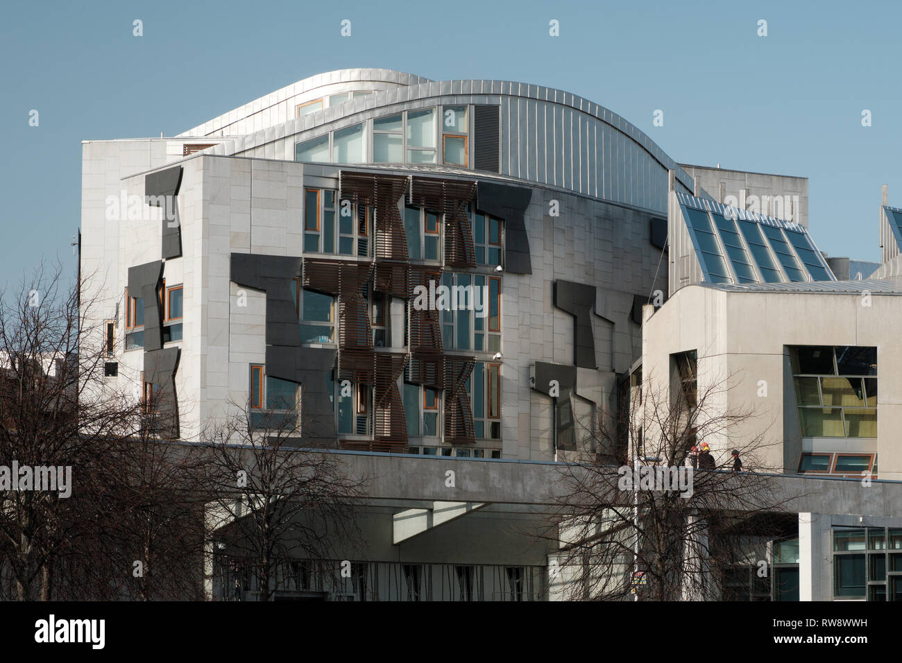 Exterior of the front of the Scottish Parliament Building at Holyrood in Edinburgh on a cloudy day - Stock Image