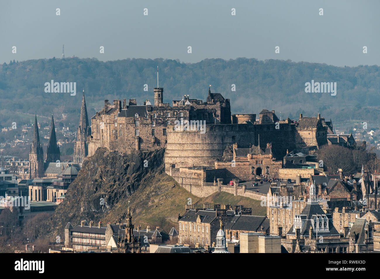 A scenic view of Edinburgh castle and cityscape from Salisbury Crags on a sunny day, Scotland Stock Photo