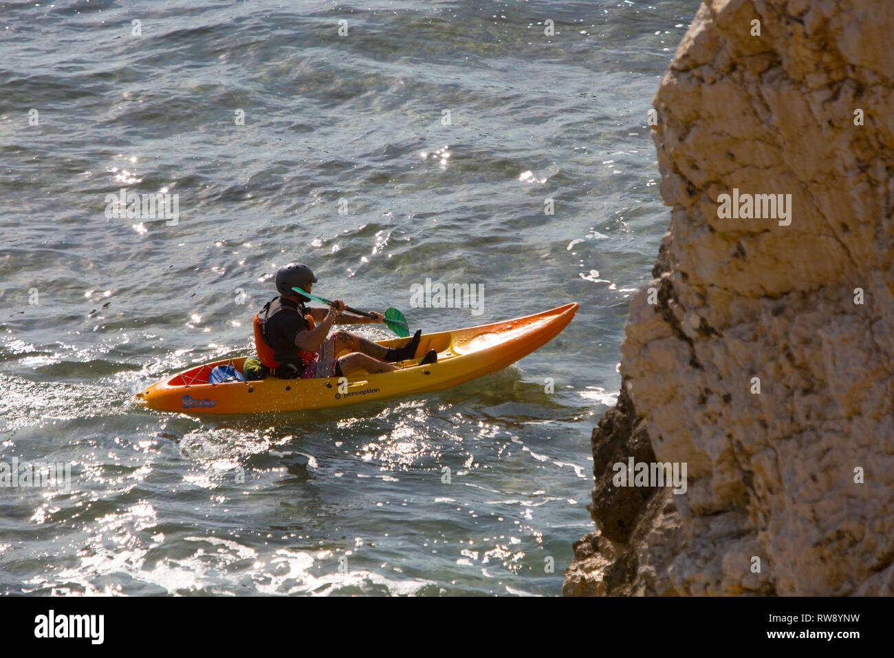 canoes,canoeists,kids,children,teenagers,paddling, paddle, school, group, holiday, adventure, outward, bound, Freshwater, Bay, Isle of Wight, England - Stock Image