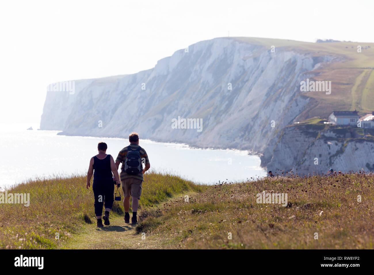 walkers, ramblers, coastal, path, Freshwater, Tennyson, Down, Bay, cliff, Isle of Wight, England, UK, Stock Photo