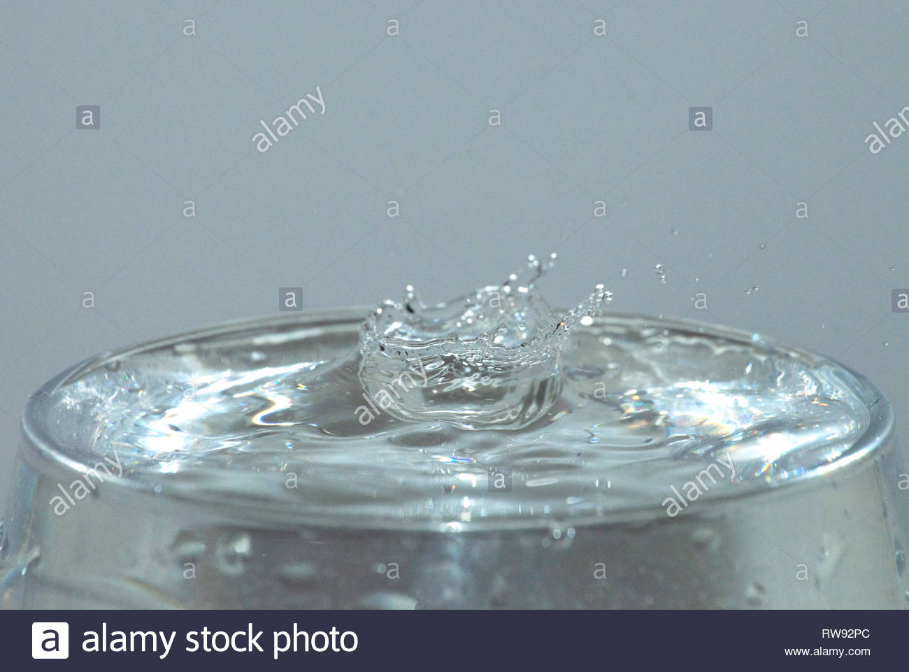 Water drop in glass - Stock Image