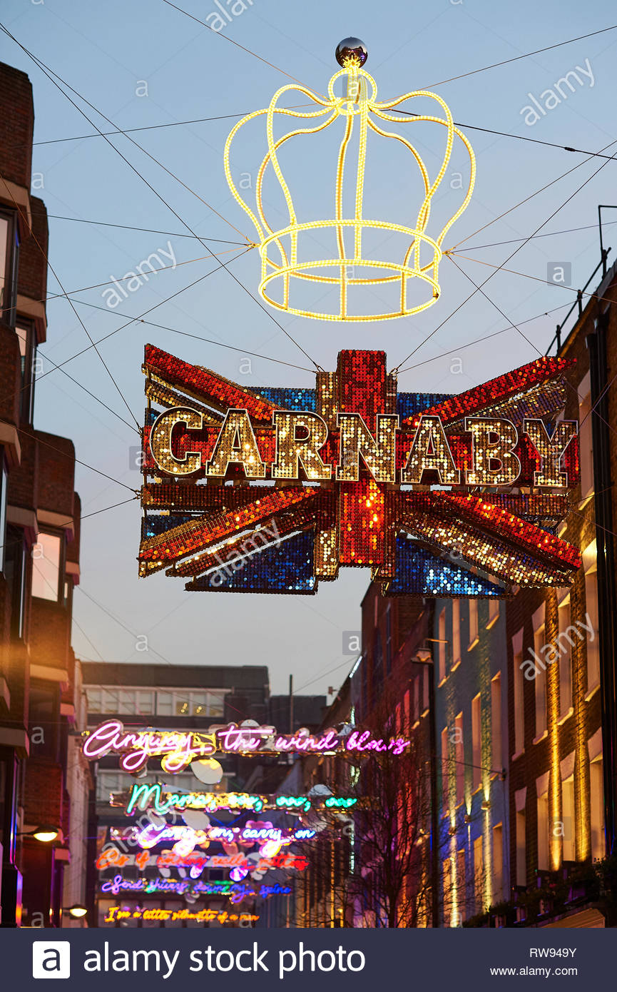 London Christmas shopping on Carnaby Street in London - Stock Image