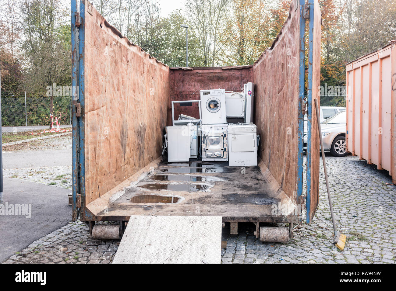 Old electrical appliances in container of recycling center  Stock Photo