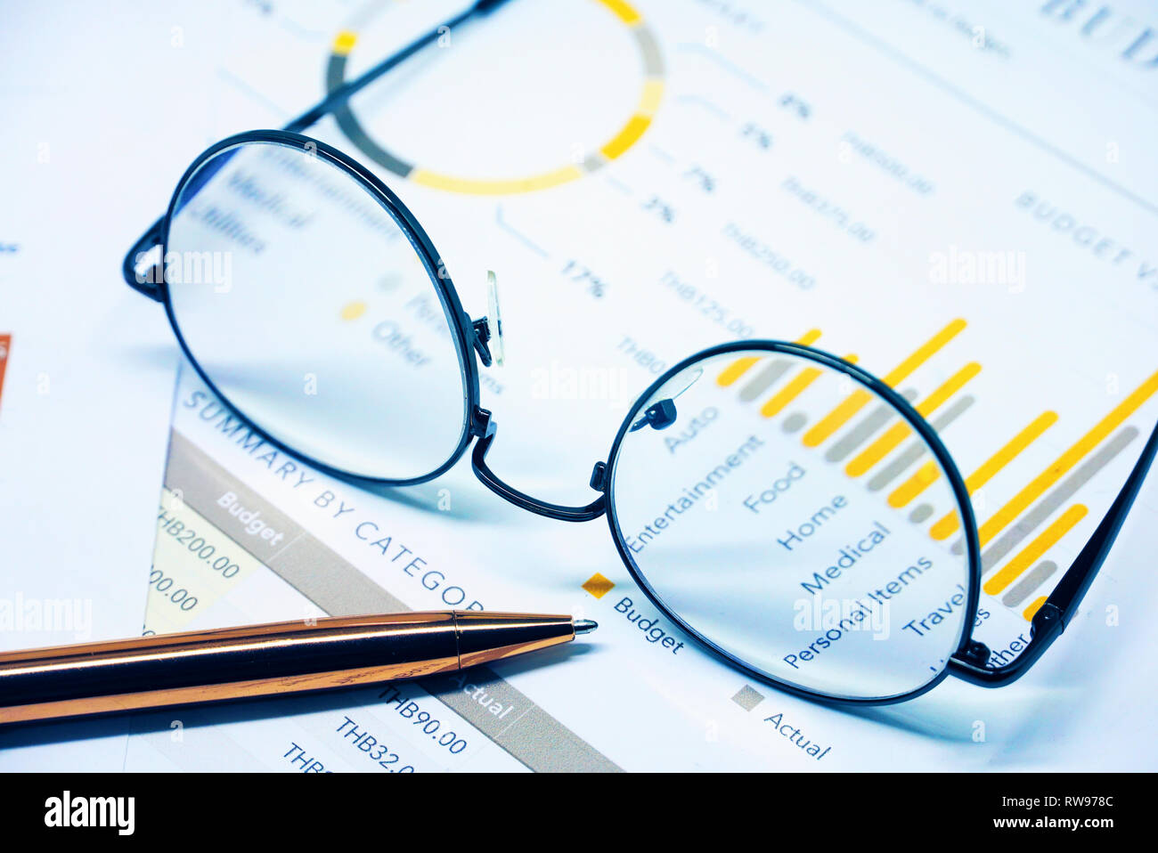 Eyeglasses on finance document - Stock Image