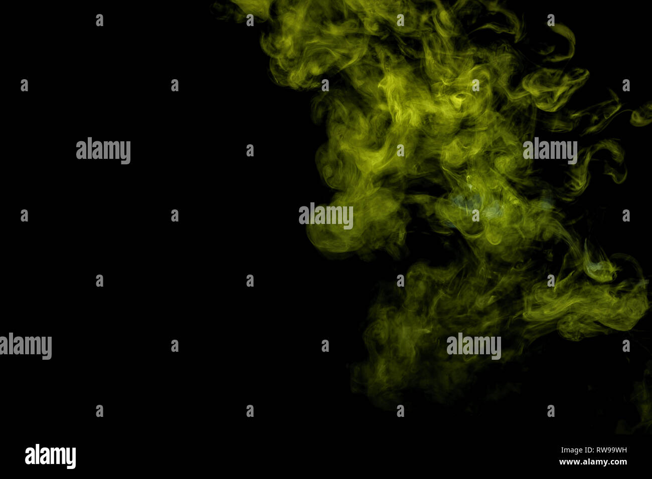 Abstract art blue and green colored smoke on black isolated background. Stop the movement of multicolored smoke on dark background Stock Photo
