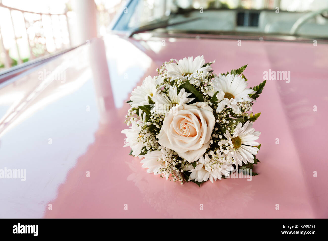 Wedding Bouquet On The Top Of Pink Car, Outdoor Wedding Day Stock Photo