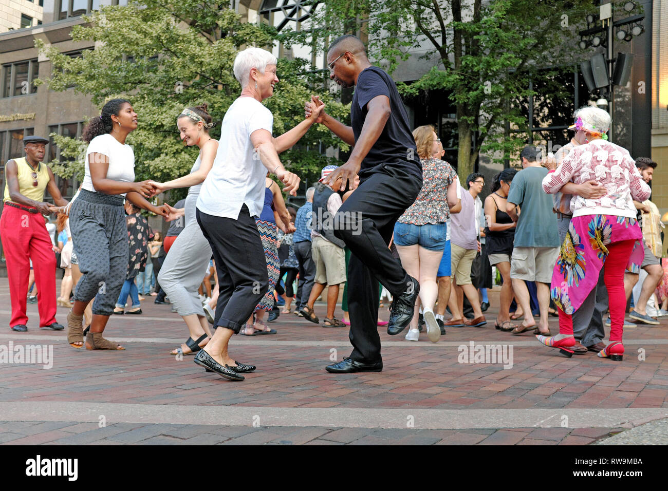 Diverse couples dance to live music on US Bank Plaza in