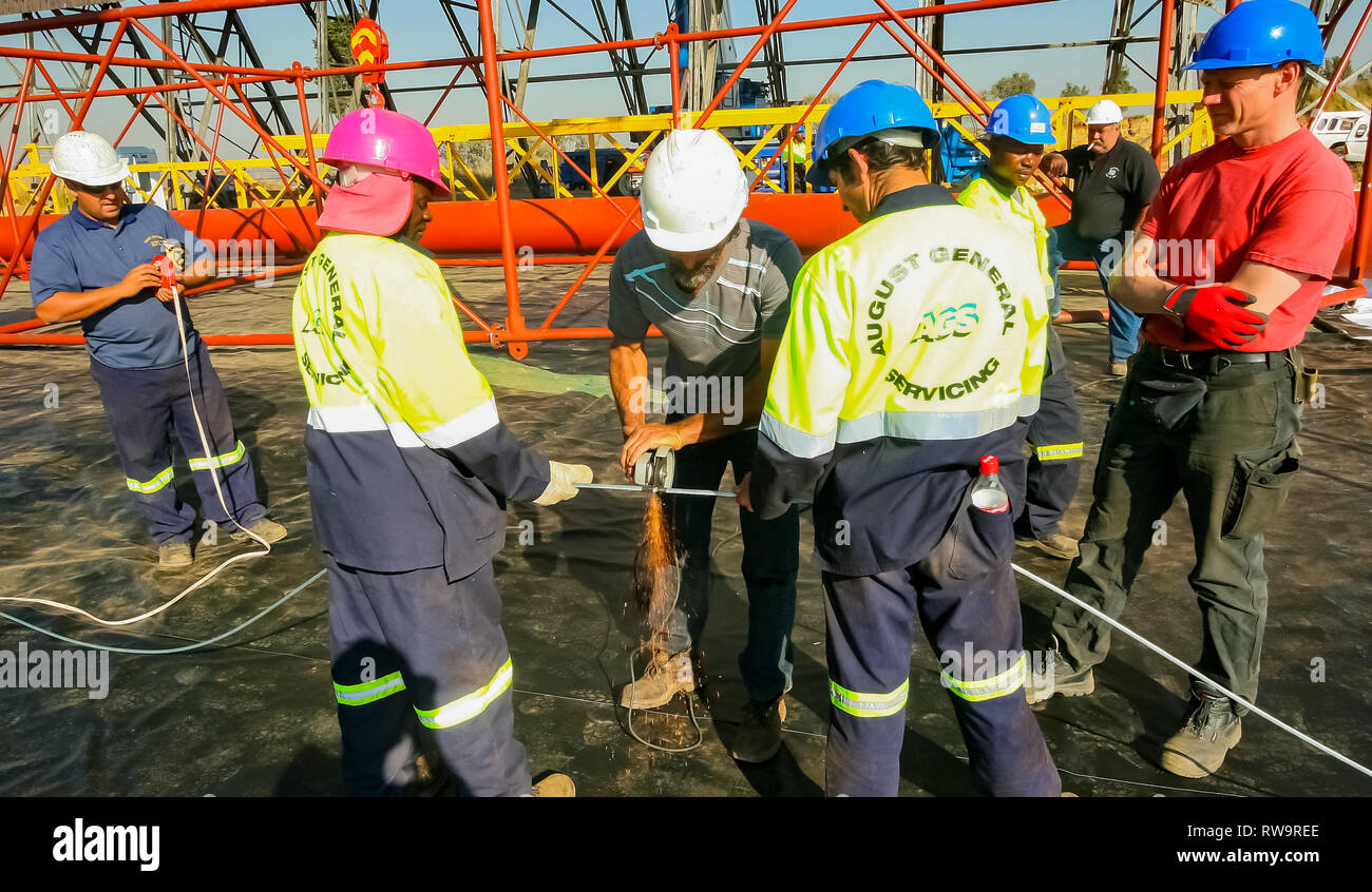 Johannesburg, South Africa - June 07 2010: Tradesman working with an angle grinder on a building site - Stock Image