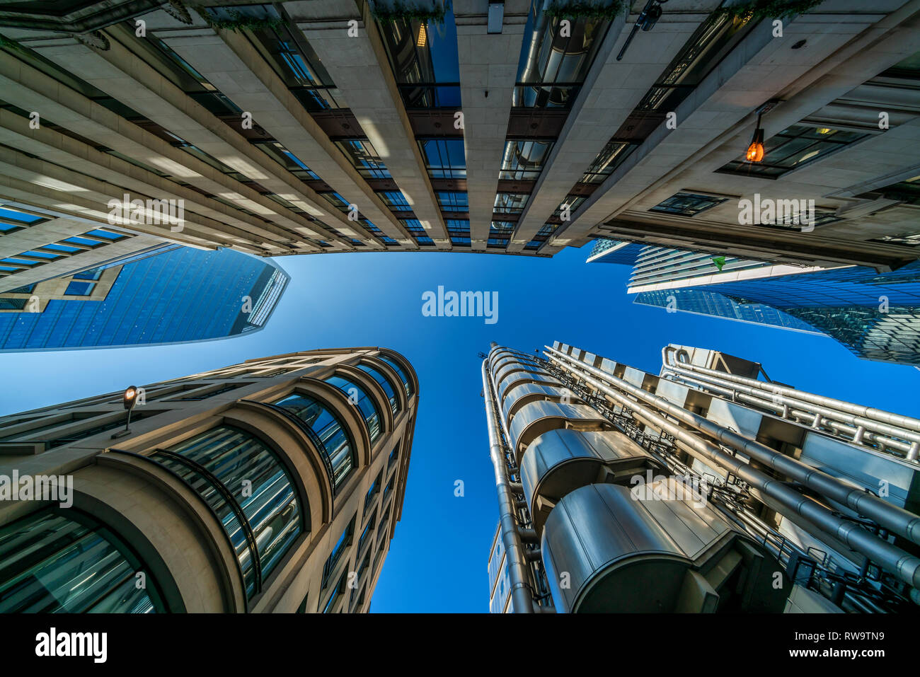 LONDON, UK - FEBRUARY 23, 2019: Upward view of  modern skyscrapers in the City of London, the heart of financial district in London. Stock Photo
