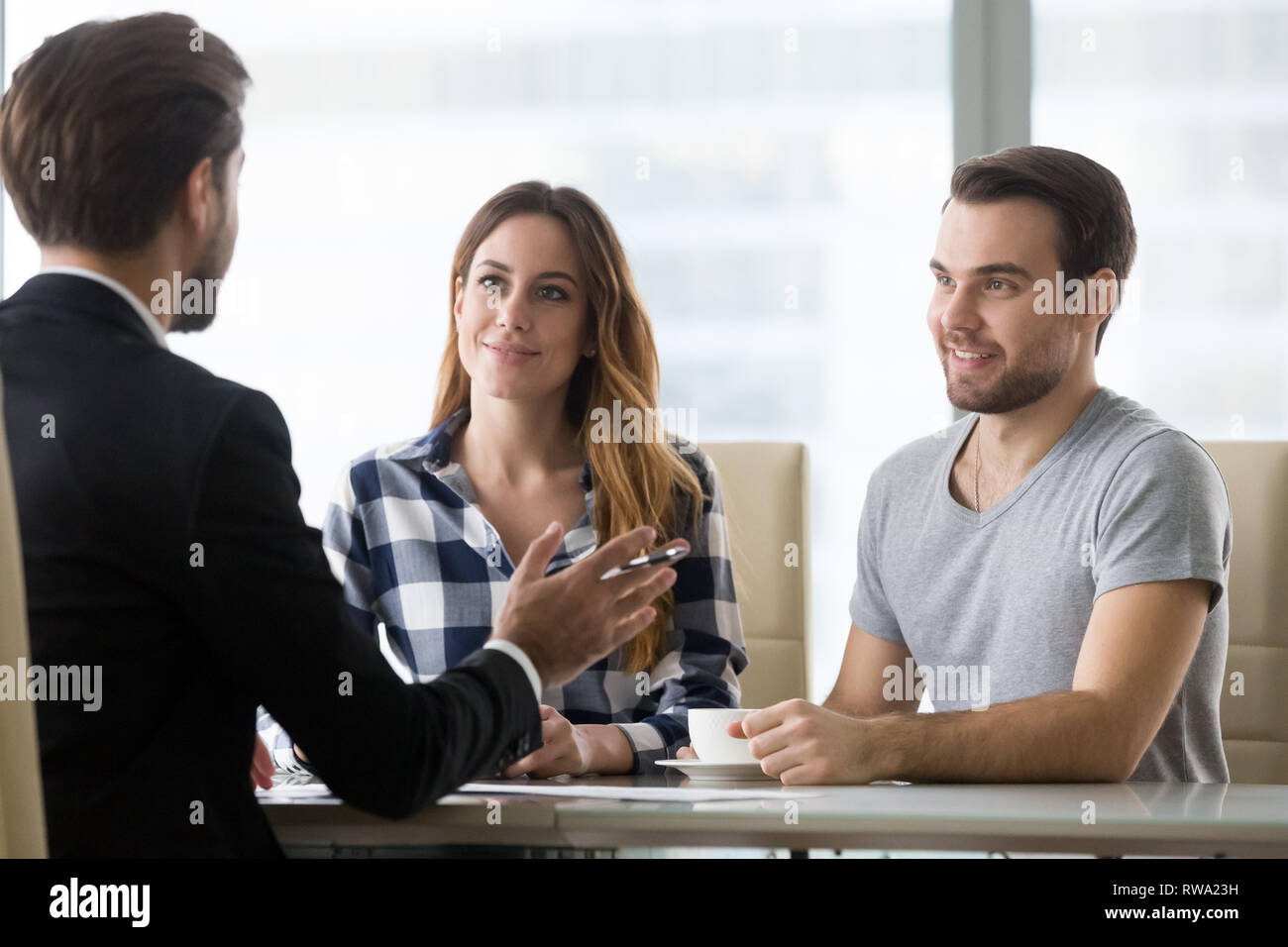 Financial advisor making presentation offer to clients at meeting - Stock Image
