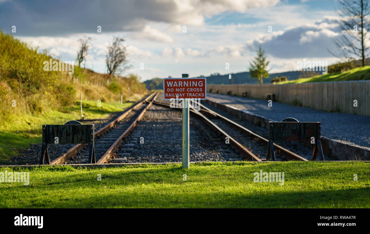 Torpantau Station, Powys, Wales, UK - October 05, 2017: Sign Warning do not cross railway tracks - Stock Image