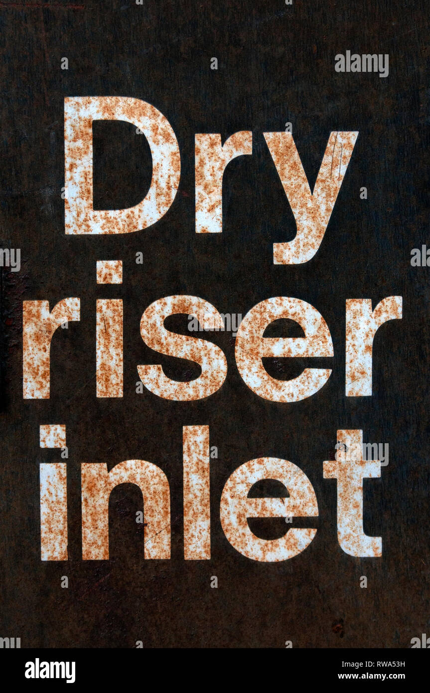 A Close Up Of A Rusty Dry Riser Inlet Sign - Stock Image