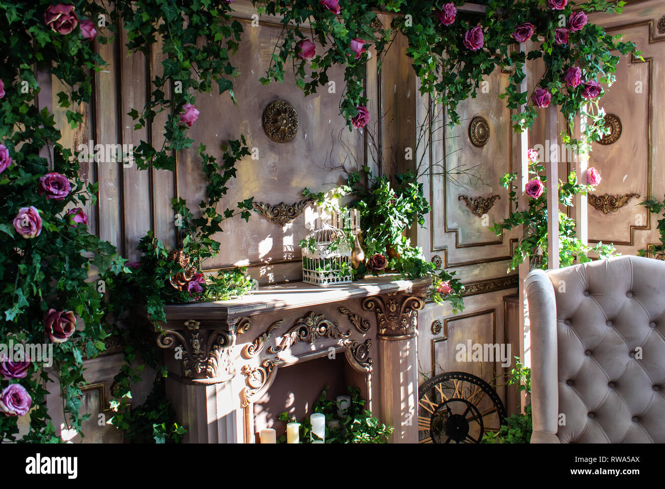 Studio decor. flowers on the walls. fireplace Stock Photo: 239324930 ...