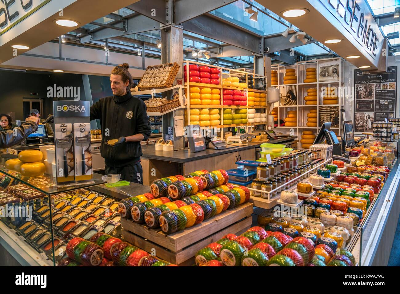 Market stall with Dutch cheese, Markthalle, Markthal, Rotterdam, Südholland, Netherlands - Stock Image