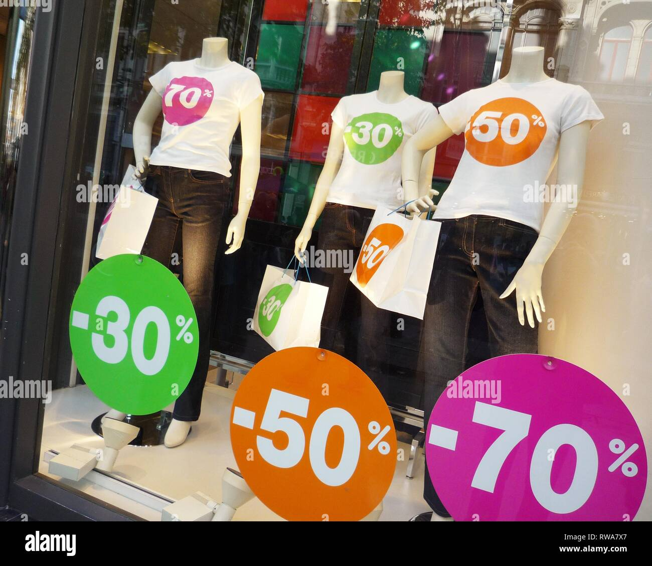 Discount, discount 50 percent, special sale, sales, shop window with mannequins from a textile shop, Belgium - Stock Image