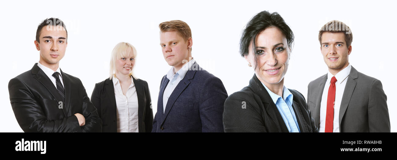 middle-aged female manager with young business team of businesswomen and businessmen - Stock Image