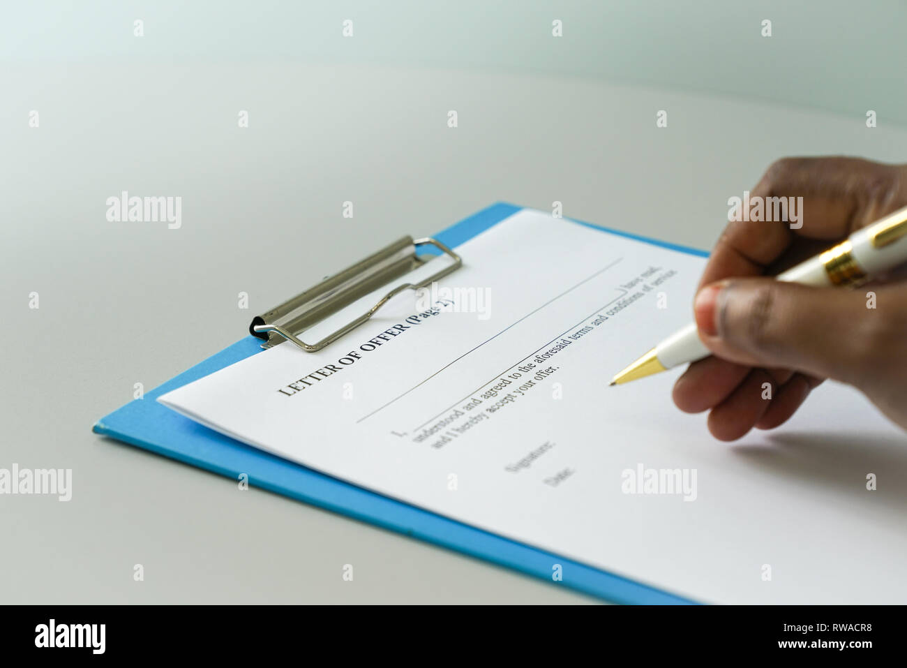 Letter of offer to be signed by potential employee - Stock Image