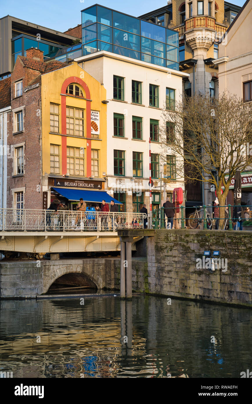 GENT, BELGIUM - FEBRUARY 17, 2019: Shop Belgian Chocolate. Bridge over the river Lys - Stock Image