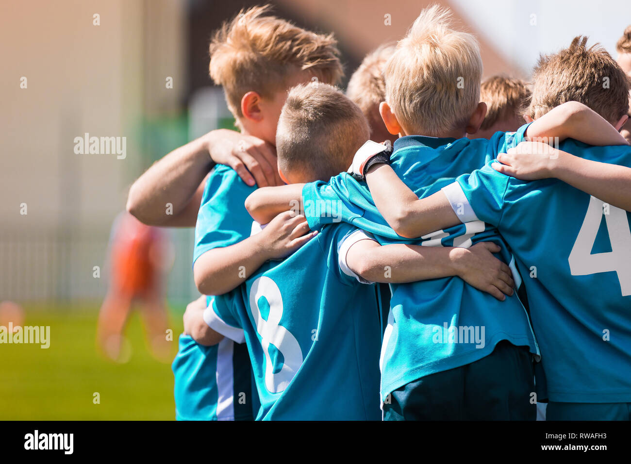 Children Team Sport. Kids Play Sports Game. Children Sporty Team United Ready to Play Game. Youth Sports For Children. Boys in Sports Jersey Red Shirt - Stock Image