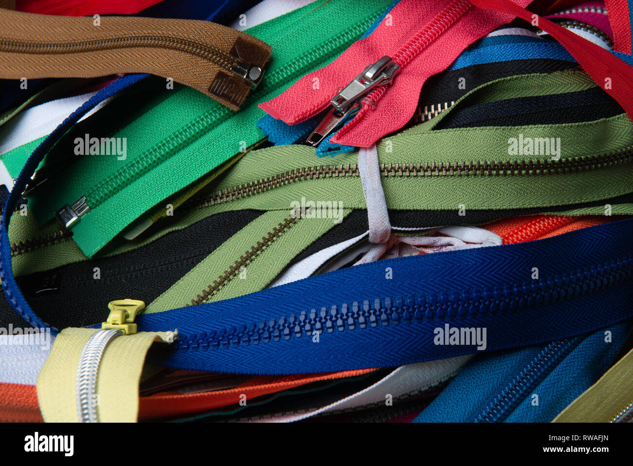 Bunch of multicolored zippers - Stock Image