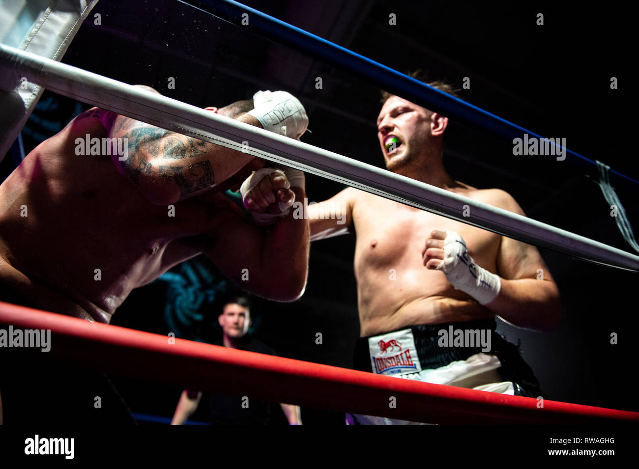 Stoke on Trent, UK. 23 February 2019. Bare knuckle and gloved fighters compete in an event held in Stoke-on-Trent. Whilst bare knuckle boxing is legal in the UK, it is currently unregulated and seen as an underground sport. Credit: Benjamin Wareing/ Alamy Live News - Stock Image