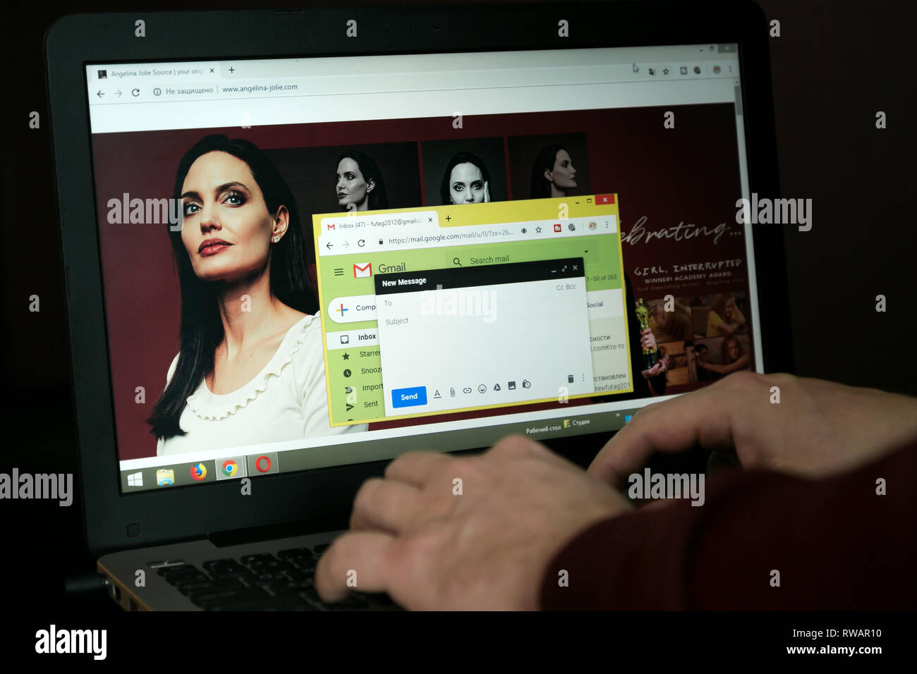 Fan of Angelina Jolly writes her an email to the site. - Stock Image