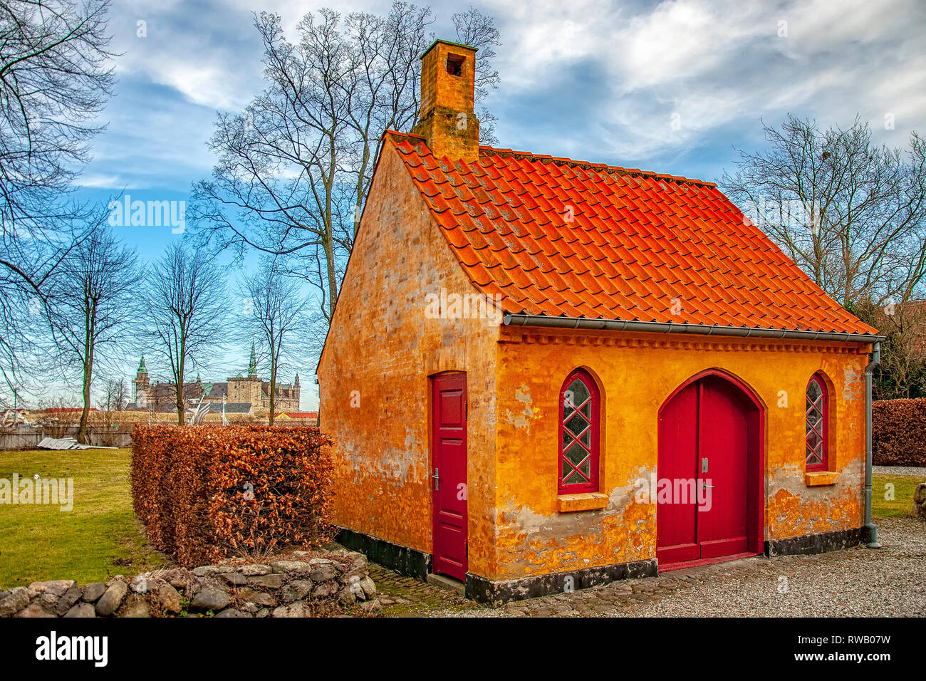 A small house on the courtyard grounds of the church of Saint Mary in the old town of Helsingor in Denmark. - Stock Image