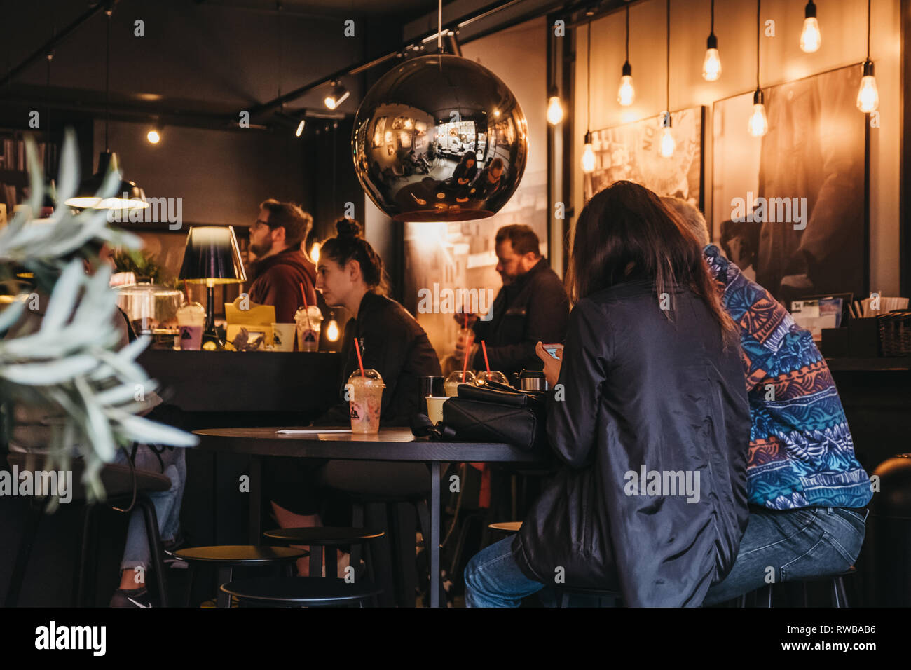 London, UK - March 2, 2019: People having drinks inside Joe and the Juice cafe in Hampstead, an affluent residential area of London favoured by artist - Stock Image