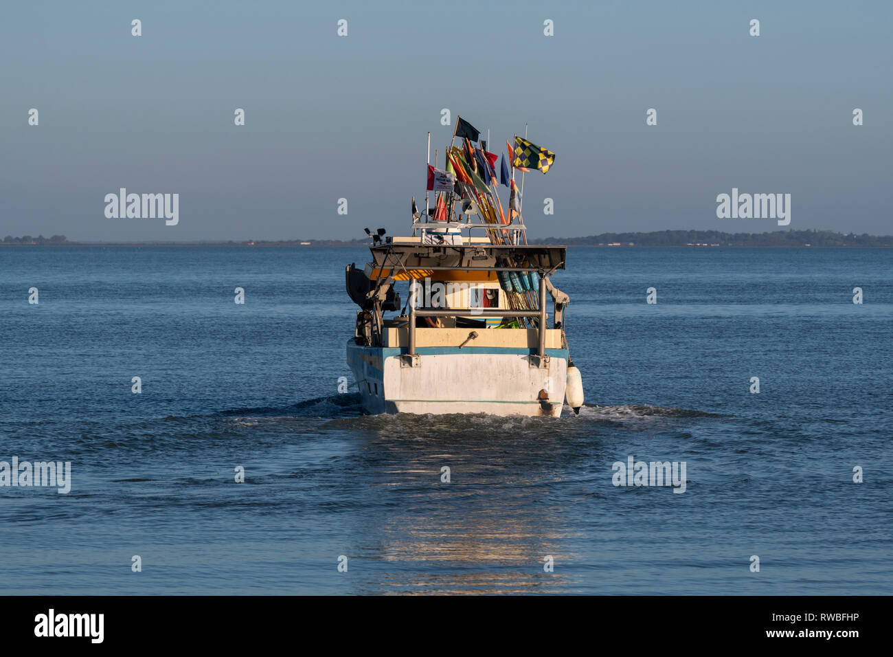 France, Oléron, 2018.   Small fishing boat  leaving the port of Château-d'Oléron - Stock Image