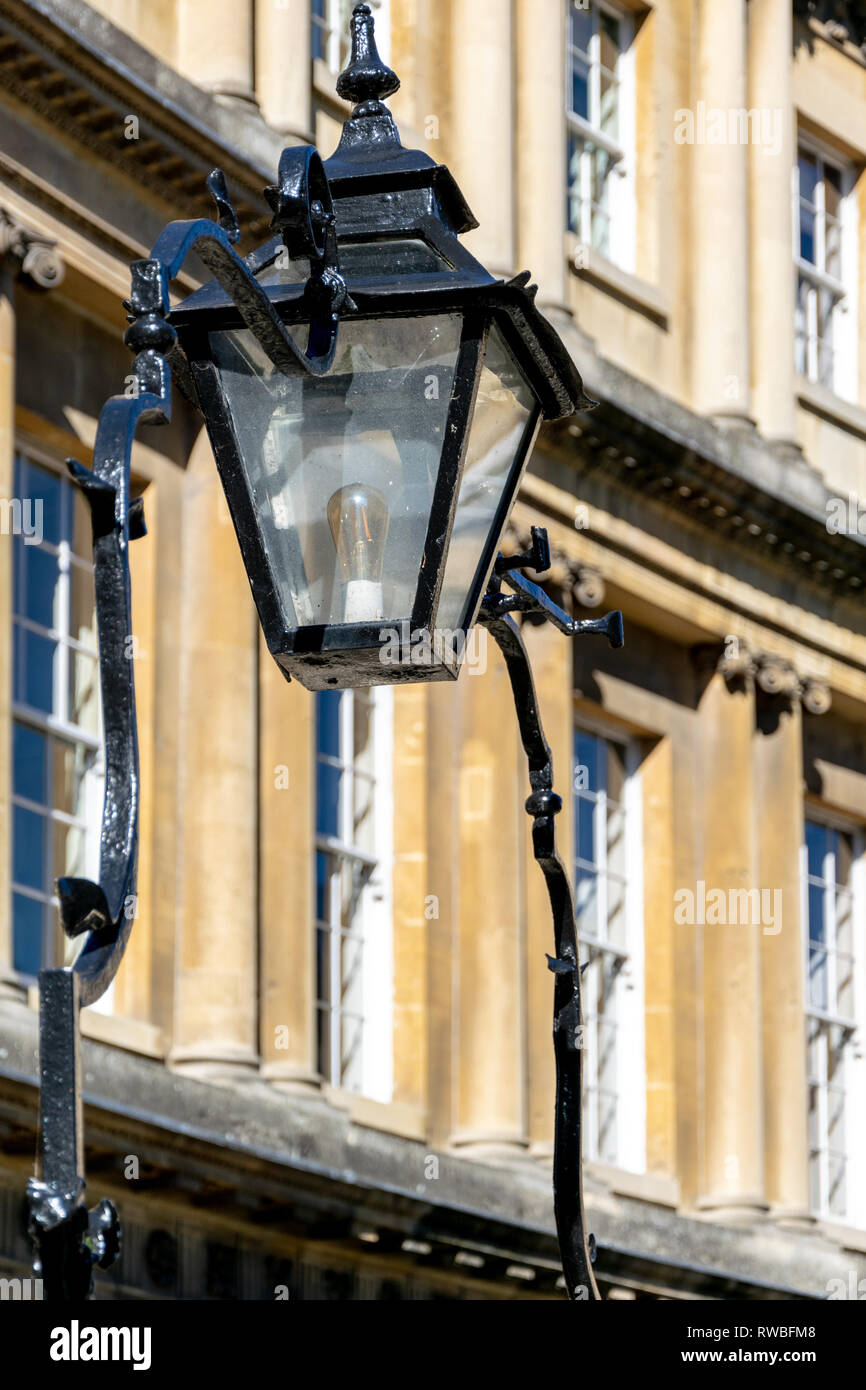 Ornate overthrow and lamp attached to the railings on The Circus, Bath - Stock Image