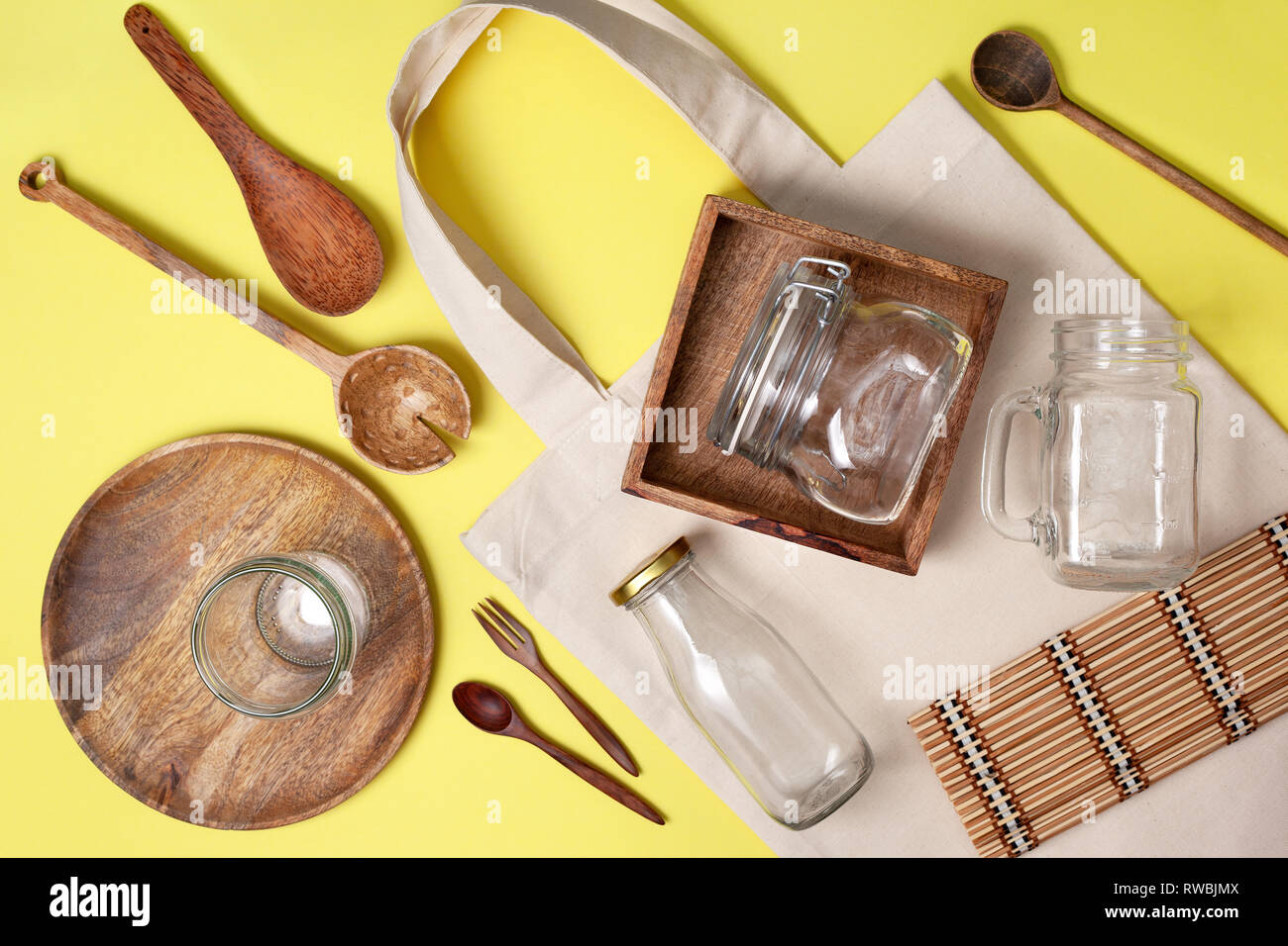 Zero Waste Concept Eco Friendly Kitchen Set For Cooking And Storage Of Products Eco Bag Glass Jars For Storage Wooden Dishes On A Yellow Backgroun Stock Photo Alamy