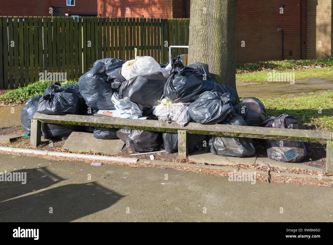 Black rubbish bags piled up on the roadside in Ladywood, Birmingham as a result of industrial action by refuse collectors - Stock Image