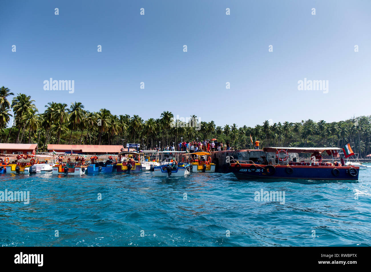 Boats ferry tourists from Port Blair to Ross Island. - Stock Image