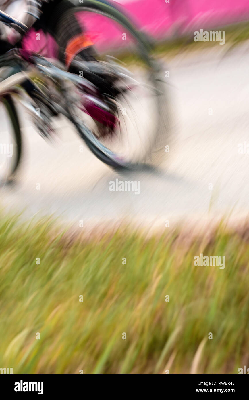 Motion blur bicycle wheel, abstract sport and recreation background - Stock Image