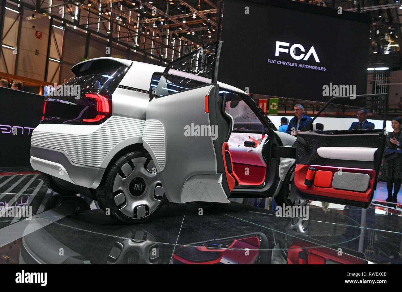 "Genf, Switzerland. 05th Mar, 2019. The electric Fiat Concept Centoventi is presented at the Geneva Motor Show on the first press day. In the background you can see the writing ""FCA Fiat Chrysler Automobiles"" to which Fiat belongs. The 89th Geneva Motor Show starts on 7 March and lasts until 17 March. Credit: Uli Deck/dpa/Alamy Live News Stock Photo"